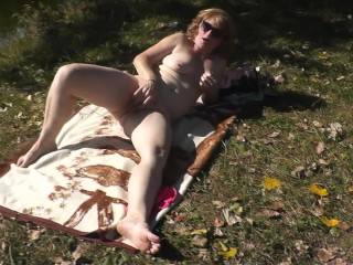 Naked wifey Milf masturbates by river in nature. Strong orgasm naked girl Hairy cunt blonde closeup