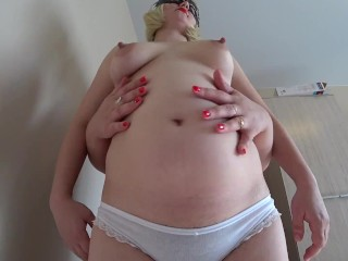 Chubby lesbian with strapon fucks pregnant gf in her hairy vagina.